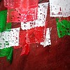 papeles picados on red stucco (msdonnalee) Tags: red rot paper mexico rouge rojo banner craft vermelho mexique rosso mexiko messico красный röd mexicanfolkart punainen 赤 赤い 빨간 redwhiteandgreen κόκκινοσ photosfromsanmigueldeallende papelespicados fotosdesanmigueldeallende 红的 perforatedpaperbanner أَحْمَر