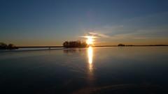 P1030525 (Remko van Dokkum) Tags: sunset sun ice set zonsondergang iceskating skating zon schaatsen schaats ondergang natuurijs uitdam