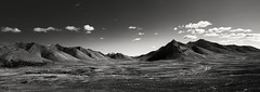 Dempster Highway and Angelcomb Peak (eyebex) Tags: autumn blackandwhite bw canada mountains fall landscape geotagged delete5 open view deleteme10 delete7 north ridge yukon saveme8 vista getty save10 peaks 75 107 vast savedbythedeletemeuncensoredgroup butilikeit cool7 tombstoneterritorialpark angelcombmountain geo:lat=64610338 geo:lon=138404217 uncool5 iceboxcool