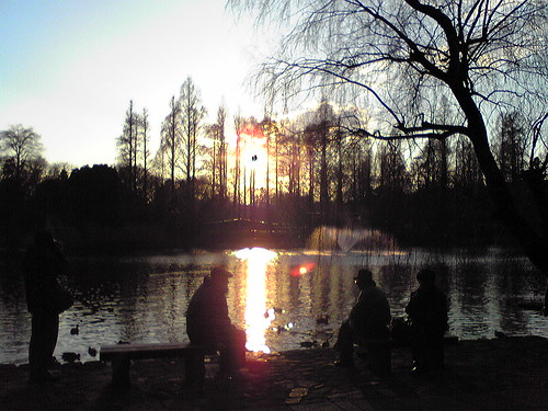 3 old men watching the sunset at Inokashira Pond