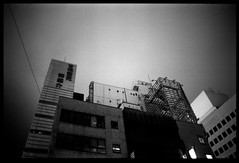 Bright Night (gullevek) Tags: sky blackandwhite japan night clouds geotagged tokyo fuji 日本 東京 雲 空 iso1600 housebuilding モノクロ 汐留 中央区 olympusom2n fujineopansuperpresto1600 epsongtx900 zuikomc28mmf2 geo:lon=139762251 geo:lat=35666623