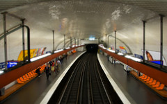 parisian metro...  tilty-shifty (djdphotos) Tags: above paris france station train photoshop subway high saturated nikon waiting colorful europe raw metro louvre tracks fake railway trainstation metropolitain justforfun cs3 tiltshift d40 fauxtiltshift reinterpreted
