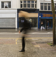 One Legged Shopper (Malcolm Bull) Tags: street city motion sussex brighton empty east shops economic let recession downturn 090328street001edited1web