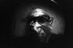macabre (thengl) Tags: blackandwhite selfportrait monochrome face dark scary lomo lomography availablelight iso400 highcontrast fisheye multipleexposure monocromatic horror grimace existinglight macabre f80 kodakbw400cn kontrast antic dunkel c41process fisheye2 fratze schwarzweis mehrfachbelichtung grotesqueface 1100sec