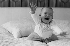 Joy! (Harri_1970) Tags: portrait blackandwhite bw motion girl smile childhood canon fun happy kid bed bedroom funny soft dof child hand bokeh joy young lisa move canon5d ilo tytt