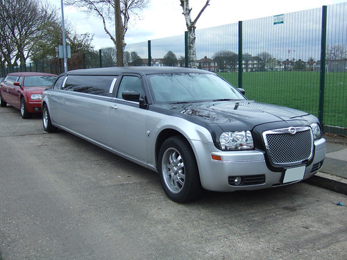 Two tone Black/Silver Chrysler limo. A Chrysler 300 stretch in two tone