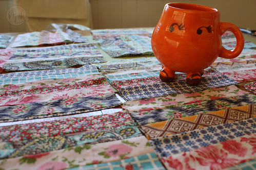 funny orange mug in a field of quilt scraps