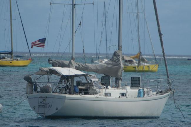 Dosia at anchor in a nice breeze.  Outside Marina Taina, Papeete, Tahiti