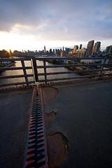 Jaws (_Esc) Tags: nyc sunset sky leather metal skyline brooklyn clouds fence pose graffiti nikon sigma dirt pulaskibridge empirestatebuilding drawbridge chryslerbuilding greenpoint beams longislandcity 1224 newtoncreek d700