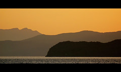 , 2009 (ssj_george) Tags: camera leica bridge sunset sea sky orange seascape mountains colour water lens landscape island greek lumix gold golden mediterranean view sundown silhouettes shades panasonic greece crete layers dmc cretan chania  kriti superzoom    pelagos canea kritiko georgestavrinos  fz28  ssjgeorge mygearandme  giorgosstavrinos
