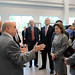 Engineering Dean Louis Martin-Vega, left, gesturing, talks with Chancellor Woodson and others at the FREEDM Center.
