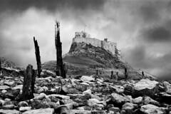Lindisfarne Castle (Stuart Stevenson) Tags: sea england blackandwhite bw white storm black castle rocks canon300d northeast berwick holyisland lindisfarnecastle cmwdweeklywinner stuartstevenson stuartstevenson