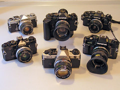My Olympus OM camera collection with various lenses (Hans Marvell) Tags: olympus zuiko om1 om40 om2sp om4t om10quartz