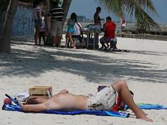 Beach life (Toni Kaarttinen) Tags: usa beach america keys unitedstates florida palm keywest suntanning