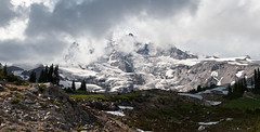 Rainier and Clouds (absencesix) Tags: trees sky panorama plants usa snow mountains nature weather clouds walking iso200 washington unitedstates hiking events july noflash mountrainier mountrainiernationalpark northamerica wa 2009 atmospheric ef2470mmf28lusm hikes locations locale verticalstitch manualmode 46mm canoneos30d camera:make=canon geo:state=wa exif:make=canon exif:iso_speed=200 exif:focal_length=46mm activityaction hasmetastyletag naturallocale adjectivesfeelingdescription mountainsmountainranges 1500secatf80 selfrating5stars july252009 mountrainierwa07252009 geo:countrys=usa exif:lens=ef2470mmf28lusm exif:model=canoneos30d camera:model=canoneos30d exif:aperture=80 subjectdistanceunknown geo:city=mountrainiernationalpark mountrainiernationalparkwausa geo:lat=46793418089668 geo:lon=12173687636834 464736n1214413w