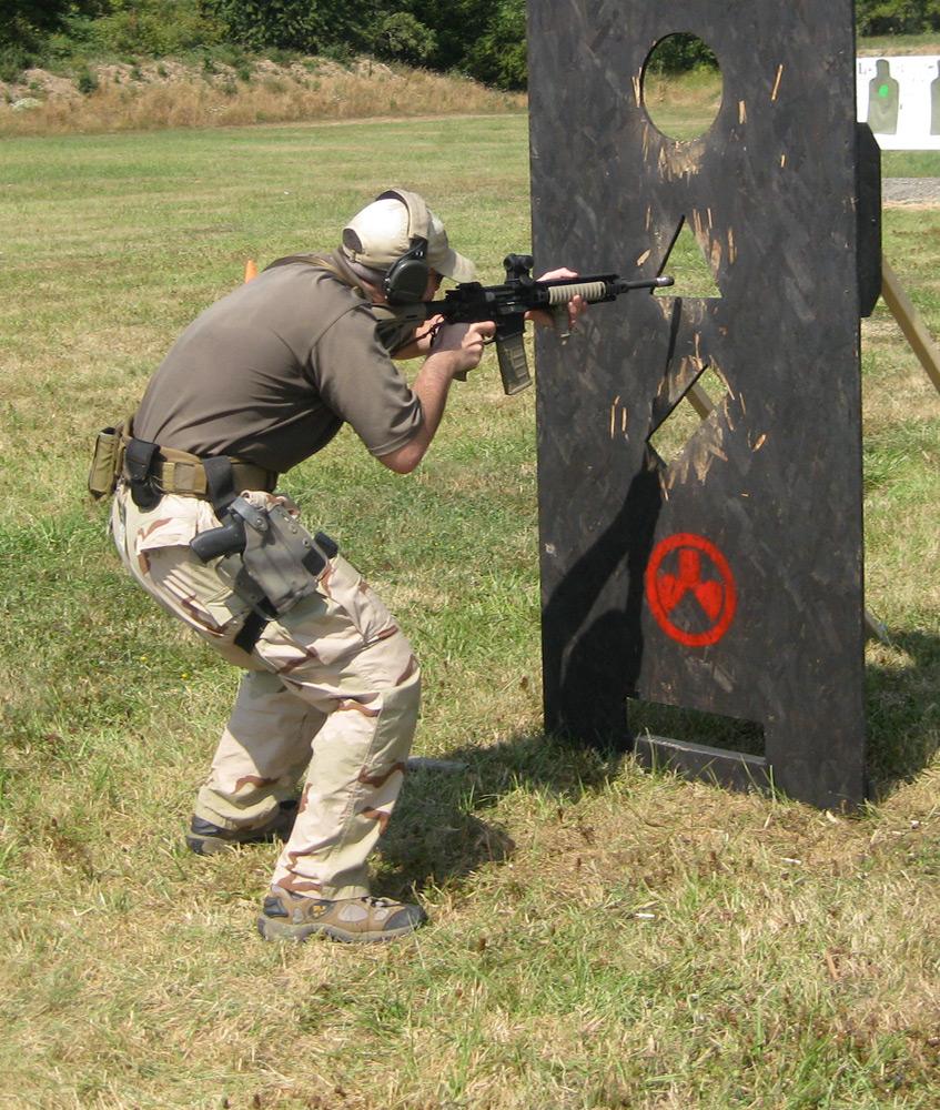 Photo : Special Reaction Team Soldier Firing Through Barricades