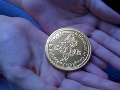 "Oxford, ""Eat Me"" chocolate coin w/hands"