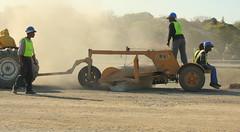 Men at Work (Megan Skelly) Tags: street colour yellow workmen roadworks vests dust hardhats eastlondonsouthafrica