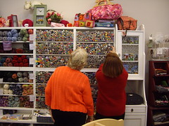 Owner Janet assisting a customer match buttons to a project