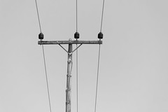 one, two, three (Daniel Kulinski) Tags: trip sea summer vacation blackandwhite bw sun white black hot beach water monochrome electric wire sand image 10 evil samsung minimal pole greece ten lamps minimalism simple rodos minimalistic nx blackwhitephotos rodhos  samsungimaging nx10 samsungnx10