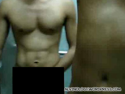 Hmm... what can two naked men be up to, stuck in a HDB lift?