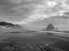 Cannon Beach, Oregon (J K Johnson) Tags: ocean sea sky usa storm rock clouds oregon us interesting sand peaceful stormy roadtrip haystack geology cannonbeach haystackrock blackandwhitesky geological jimjohnson jkjohnson