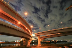 flyover 0015 (James_Wheeler) Tags: road longexposure light sky cloud color art lines japan night canon river rebel tokyo evening highway angle curves wide perspective engineering structure depthoffield civil artery expressway tamron parallel sumida flyover 1118mm 400d