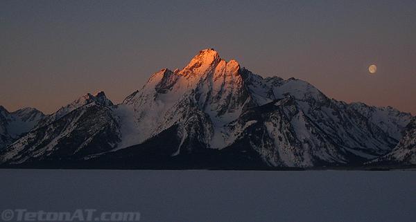 Moon and Sunrise on Mount Moran
