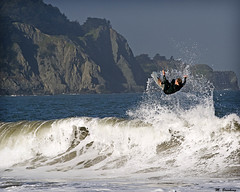 Does he land it?? (Michael Brooking Photography) Tags: ocean sanfrancisco california mountains big surf air wave surfing spray goldengate bakerbeach hangloose wetsuit supershot michaelbrookingphotography
