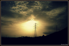 Light is good from whatever lamp it shines...[Explored #258] (D a r s h i) Tags: light sunset sky sun nature yellow electric clouds sunrise evening silhouettes wires electricity pune