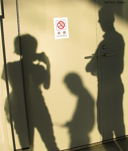 shadow trio on train platform in Japan