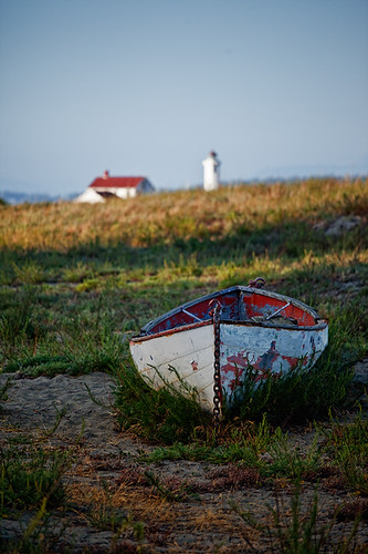 Old Boat and Point Wilson Lighthouse