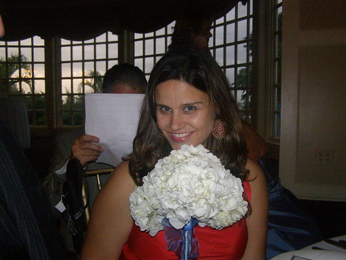 With a bridesmaid's bouquet