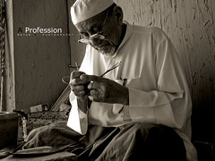 A Profession (Rayan M.) Tags: old portrait art heritage history sepia work antique culture kingdom saudi arabia shoemaker  profession                 alqasime   aprofession  passionofwork