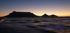 Cape Town at sunset (jan-krux photography) Tags: city sea sky mountain beach water beautiful landscape southafrica lights evening capetown e1 tablemountain westerncape zd woodbridgeisland 1454mm bej worldbest blaubergstrand