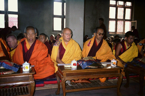 Attending Lamdre, Senior lamas in the front row of the yet unfinished Tharlam Monastery of Tibetan Buddhism, windows open so the birds fly through, praying, enjoying tea, Boudha, Kathmandu, Nepal, in 1990 by Wonderlane