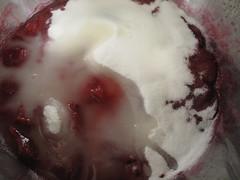 Sugar and lemon juice in plum jam