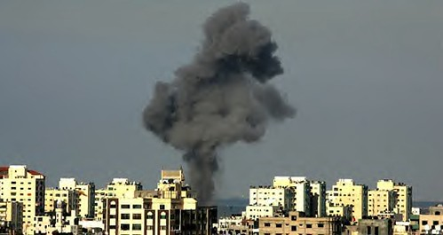 A Gaza explosion from Israeli aerial bombardments of the people. Hamas, the legitimately elected government of the Palestinian Authority, has been villified in the corporate press. by Pan-African News Wire File Photos