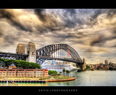 The Tempestuous Sydney Harbour Bridge :: HDR (:: Artie | Photography ::) Tags: bridge cruise cloud storm wet rain weather photoshop canon bravo ship view searchthebest angle cs2 cloudy wide sydney dramatic overcast australia stormy po handheld newsouthwales hyatt therock 1020mm harbourbridge hdr sydneyharbourbridge xoxo artie 3xp sigmalens photomatix tonemapping tonemap 400d rebelxti purplekisses moreemailsonthewayp imsendingyouanemaillmao