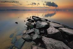 Arrowhead sunrise (Ragstatic) Tags: rags d80 nikon singapore relax sunrise water smoke rocks sembawang reflection dawn longexposure color singaporebeach singaporelandscape landscape seascape dri