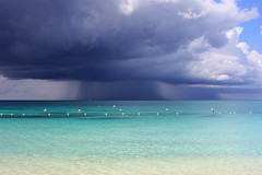Rainstorm off Seven Mile Beach, Grand Cayman (Don McDougall) Tags: sea sky mer storm water rain clouds 100views rainstorm caribbean 100 cayman caymanislands grandcayman sevenmilebeach mcdougall donmcdougall