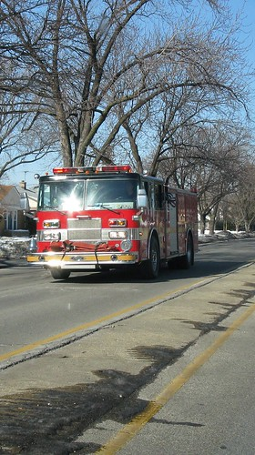 Southbound Niles Fire Department fire truck speeding to an emergency call. Niles Illinois. Early March 2009.