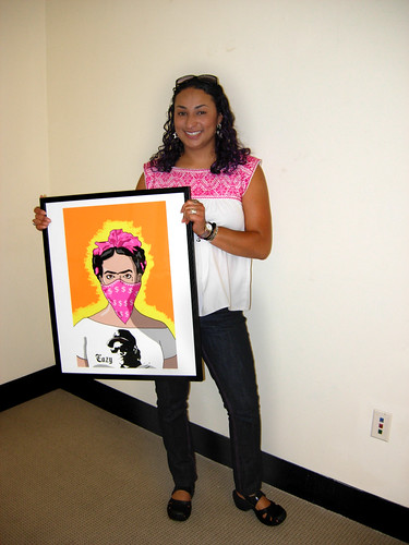 Curator Rachel Anne Palacios holds one of My Ghetto Frida prints