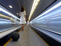eSpalding (piriskoskis.) Tags: barcelona people woman motion colors girl station ball underground subway movement metro geometry bcn tube perspective tunnel walkway pili tmb travelator spalding  fz18