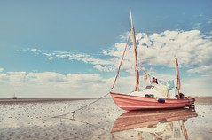 the sea is the sea (besimo) Tags: summer sun water clouds island boat sand mud 20mm hdr watt wangerooge sandclouds d700 besimmazhiqi levelandtap alittlebitseventies alittlebitme alittlebitpolaroidblur
