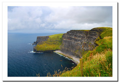 The Cliffs of Moher (2). Ireland.- (ancama_99(toni)) Tags: ocean county trip travel blue ireland light sea vacation sky irish cliff paisajes naturaleza holiday color green beach nature water azul clouds marina landscape geotagged photography coast mar photo agua nikon europa europe clare waves photos doolin playa photographic irland eire cliffs atlantic cliffsofmoher paysage paesaggi olas atlanticocean 2009 emeraldisle aigua moher attraction atlntico irlanda paisagens irlande oceano 1000views marinas atlantico countyclare ocano d60 acantilados eireann republicofireland cliffofmoher landschaftsaufnahmen 25faves p1f1 ancama99 7naturalwonders saariysqualitypictures new7naturalwonders