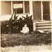 Sterling Edwards holding Jimmie Doris Edwards at Aunt Dora's.