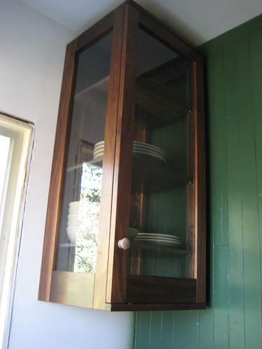 walnut & glass dish cabinet