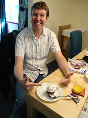 Pete and a cupcake (and massive amounts of cardboard around him)