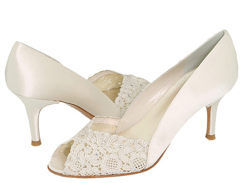 Elegant bridal shoes with the open end.